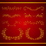 Set of elegant calligraphic foliate golden borders Stock Image
