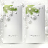 Set of elegant Christmas banners. Two banners with fir-tree branchs and Christmas toys Royalty Free Stock Photography