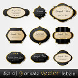 Set of elegant, dark, gold-framed labels Stock Photos