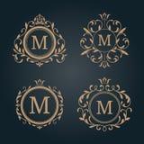 Set of elegant floral monograms. Set of elegant floral monogram design templates. Wedding monogram. Calligraphic elegant ornament. Monogram identity for Stock Photos