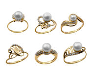 Set of elegant jewelry rings with pearl royalty free stock photo