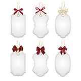 Set of elegant tags with red bows Royalty Free Stock Photography