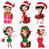 Set of elves and santa girls Stock Images