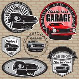 Set of emblems with retro car on wall Stock Photography