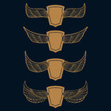 Set of the emblems with wings in gold style on blue background. Stock Image