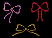 Set of embroidered ribbons red pink gold traditional Royalty Free Stock Images