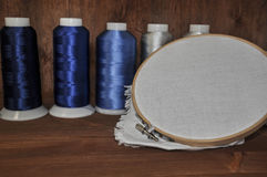 Set for embroidery of colorful threads, hoops, thimble and need Stock Photos