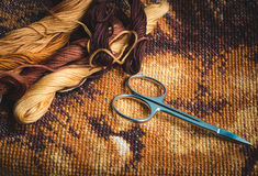 Set for embroidery, finished work, cross-stitch. Photo in low light Royalty Free Stock Images