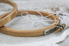 Set for embroidery, garment needle and embroidery hoop Royalty Free Stock Photo