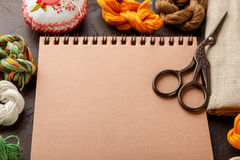 Set for embroidery. Embroidery hoop, linen fabric, thread, scissors, embroidered needle bed and notepad Royalty Free Stock Photo