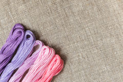 Set for embroidery with thread violet color Royalty Free Stock Photo