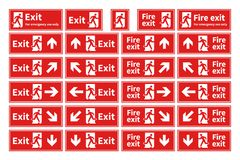 Set of emergency fire exit red signs with different directions on white. Set of emergency fire exit red signs with different directions isolated on white Stock Photo
