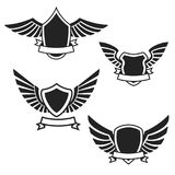 Set of the empty emblems with wings. Design elements for logo, l Stock Images