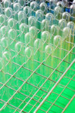 A set of empty glass test tubes in a rack Stock Image