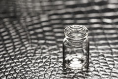 Set of Empty little bottles with black leather background Stock Image