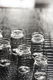 Set of Empty little bottles with black leather background Stock Photo