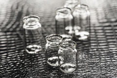Set of Empty little bottles with black leather background Royalty Free Stock Photo