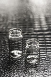 Set of Empty little bottles with black leather background Stock Images