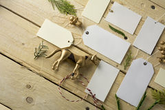 Set of empty paper price tags, wooden background Stock Photos