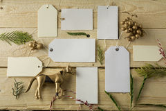 Set of empty paper price tags, wooden background Royalty Free Stock Photos