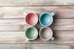 Empty pastel colored mugs stock photo