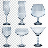 Set of empty transparent glass goblets for different drinks Stock Images