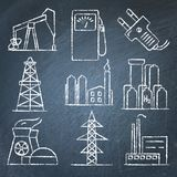 Set of energy and electricity hand drawn icons on chalkboard Royalty Free Stock Images