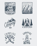 Set of engraved vintage, hand drawn, old, labels or badges for camping, hiking, hunting with mountain peaks, house, axe Royalty Free Stock Photo