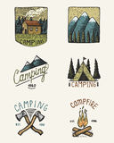 Set of engraved vintage, hand drawn, old, labels or badges for camping, hiking, hunting with mountain peaks, house, axe Royalty Free Stock Photography