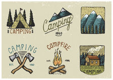 Set of engraved vintage, hand drawn, old, labels or badges for camping, hiking, hunting with tent, axe and campfire with Stock Photo