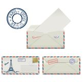 Set of envelopes from Paris with a painted the Eiffel Tower and postmark. Stylization. Royalty Free Stock Images