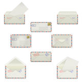 Set envelopes of various formats with postal stamps  on white background. Model mockups in four views, front and back, ope Stock Photos