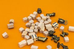 Equipment for monopoly game on orange background. Set of equipment for monopoly game on bright background stock photography