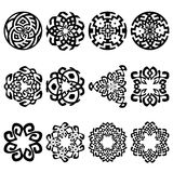 Set of 12 ethnic floral signs and design elements. Geometric patterns in black color isolated on white. Symbolic vector illustration. Could be used for textile Stock Image