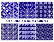 Set of ethnic geometric seamless patterns. Set of 6 ethnic geometric seamless patterns in bright blue colors. Vector illustration in eps8 format Stock Images