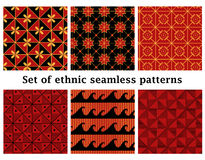 Set of ethnic geometric seamless patterns. Set of 6 ethnic geometric seamless patterns in bright red, yellow and black colors. Vector illustration in eps8 format Stock Photos