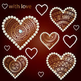 Set of ethnic golden hearts with pearls. Stock Photography