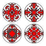 Set of ethnic oriental patterns in circle. Symmetric decorative floral filigree motifs in red, black and white Royalty Free Stock Images