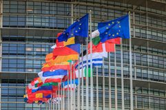 Set of European flags in front of the European Parliament stock images