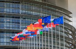 Set of European flags in front of the European Parliament. Strasbourg, France - December 28, 2017: Set of European flags in front of the European Parliament on a royalty free stock photo