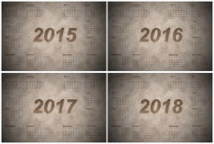 Set of european 2015, 2016, 2017 and 2018 year. Calendars with week starting from monday, vintage style stock illustration