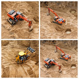 Set of excavators at sandpit during earthmoving works. Construction of concrete foundation of new building. Set of excavators at sandpit during earthmoving Stock Images
