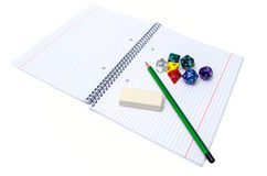 Set of exercise book, pencil, rubber and dices isolated on white Stock Photo