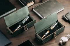 Set of expensive military pens in wooden boxes. Compositions on a dark background with attributes Stock Photos