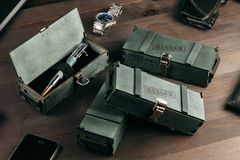 Set of expensive military pens in wooden boxes. Compositions on a dark background with attributes Stock Image