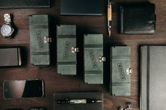 Set of expensive military pens in wooden boxes. Compositions on a dark background with attributes Stock Photo