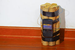 Set of explosives conected to a cellphone standing on the ground Royalty Free Stock Photography