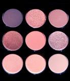 A set of 9 colors eye shadow plates stock photos