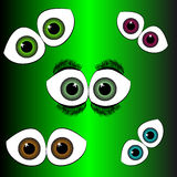 Set of eyes on green background Royalty Free Stock Image