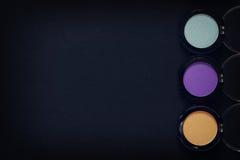 Set of eyeshadow make up on black background Royalty Free Stock Images